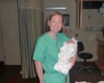 Me holding Baby Eia, one of my favorite surprise deliveries