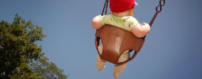 Baby Swinging in Summer